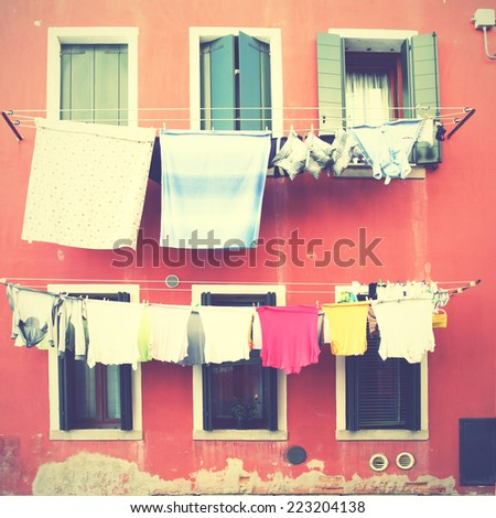 Clothes airing outdoor in Venice, Italy. Instagram style filtred image - stock photo