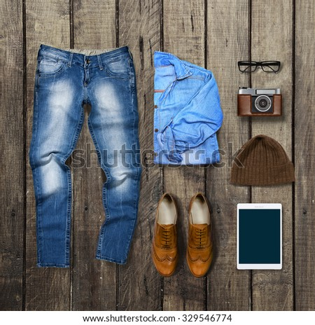 clothes and accessories on brown Wood Background - stock photo