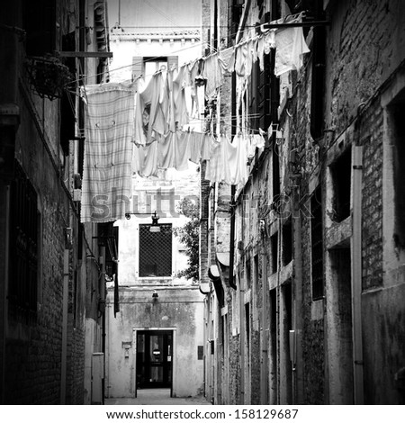 Clothes dry outdoor in Venice, Italy. Black and white image.