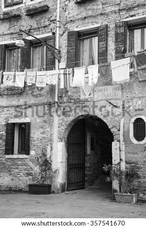 clothes drying at venetian windows, Venice, Italy