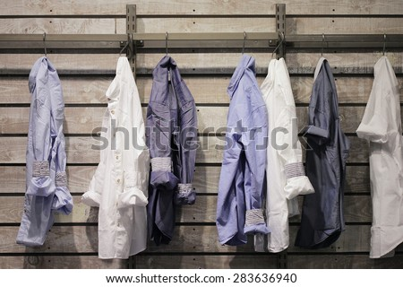 clothes hang on in a clothing store - stock photo