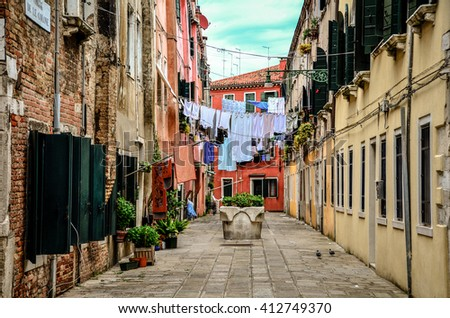 Clothes hanging across buildings to dry on a narrow alley in Venice, Italy