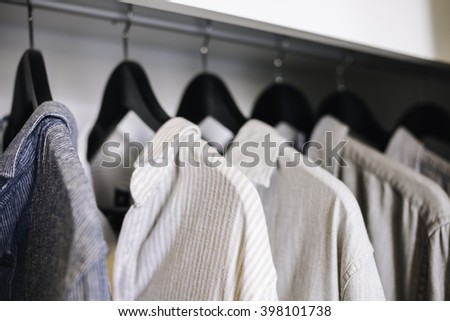 Clothes hanging in Closet Shop Fashion display