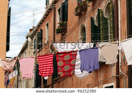 clothes hanging out to dry on a canal in Venice - stock photo