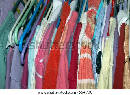 clothes hung in a womans wardrobe