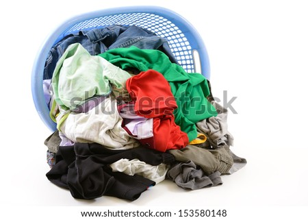 Clothes in a laundry basket isolated on white background