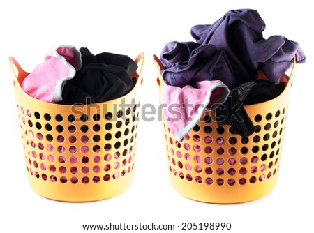 Clothes in a laundry basket isolated on white background - stock photo