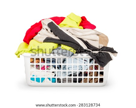Clothes in basket isolated on white - stock photo