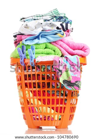 Clothes in orange plastic basket isolated on white - stock photo