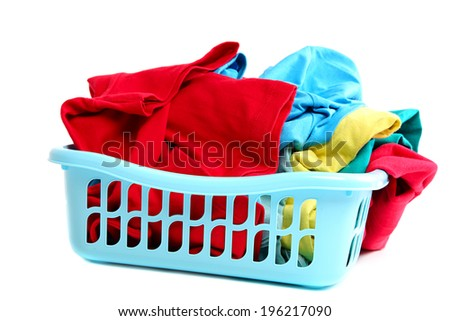 Clothes in plastic basket isolated on white background. - stock photo