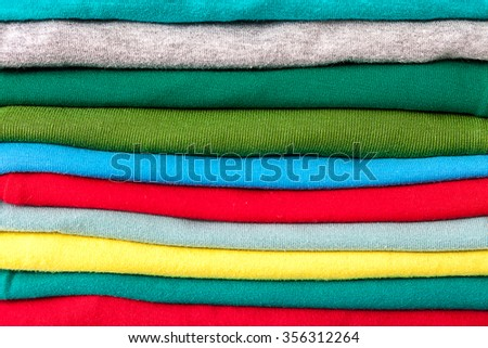 Clothes in the stack as a background. - stock photo