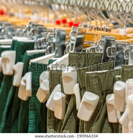 Clothes in the store with EAS anti-theft tags - stock photo