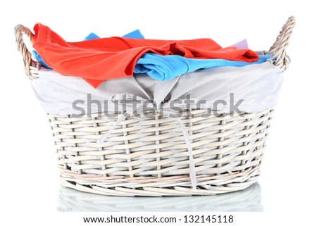 Clothes in wooden basket isolated on white - stock photo