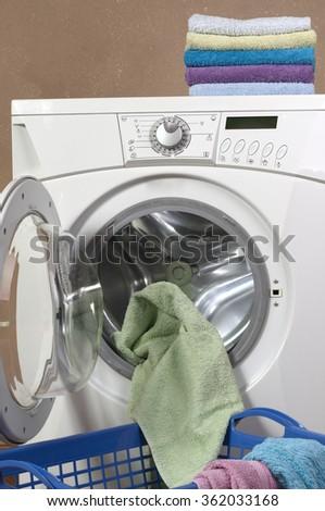 Clothes inside of washing machine taken closeup - stock photo