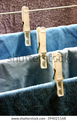 clothes on a line, clothespins - stock photo