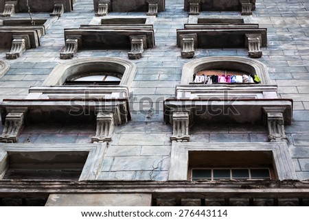 clothes on balcony of the old house - stock photo