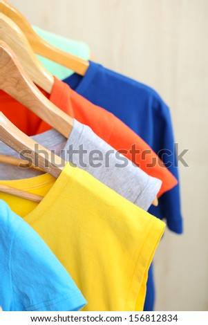 Clothes on hanger on light background