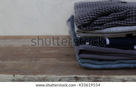 clothes on wooden background / soft focus - stock photo