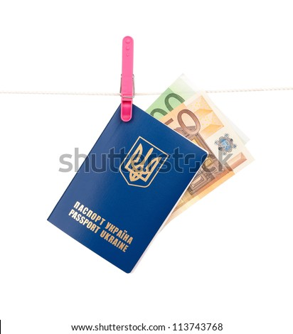 Clothes-peg holding international Ukrainian passport with Euro banknotes on a rope isolated on white background - stock photo