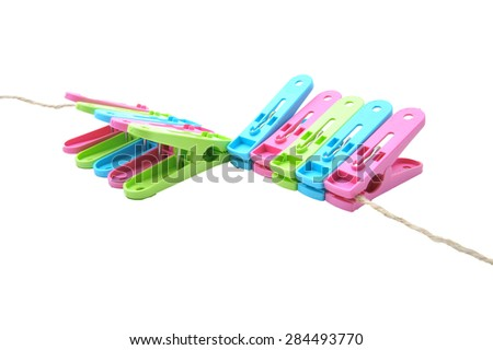 clothes-pegs isolated on a white background. Slightly defocused and close-up shot.  - stock photo
