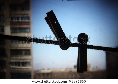clothes-pegs on  string and sky, holga lens photography - stock photo