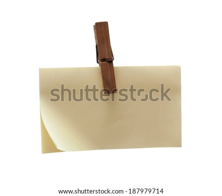 Clothes pin holding blank note isolated - stock photo