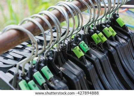 clothes plastic hanger hanging on the rod - stock photo