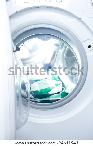 clothes washer with green fabric