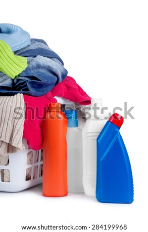 Clothes with detergent and in  plastic basket dropped isolated o