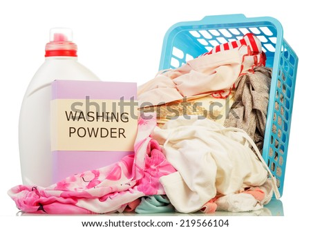Clothes with detergent and washing powder in plastic basket isolated on white - stock photo