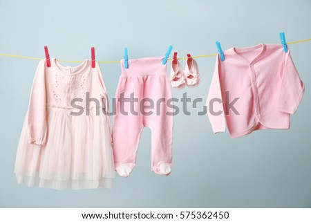 clothesline hanging baby clothes on grey stock photo edit now