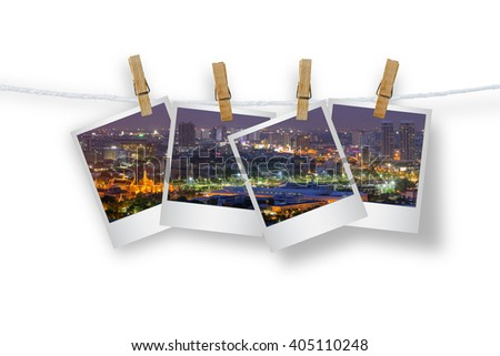 Clothespin hanging with photo landscape views of Bangkok. Isolated on white with clipping path.
