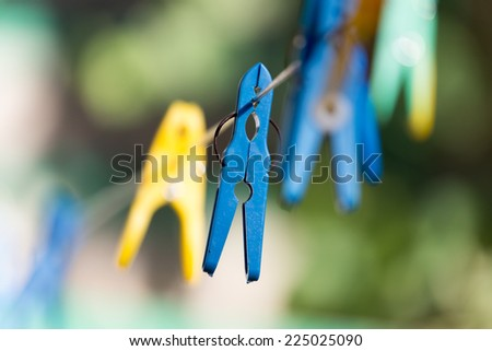 clothespin on a clothesline - stock photo