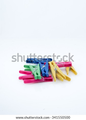 Clothespin over a white background