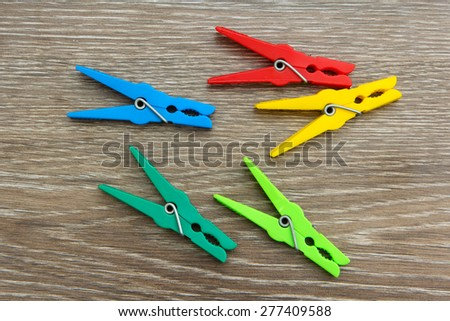 clothespins lie on a wooden board - stock photo
