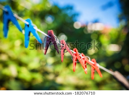 clothespins on a rope in the yard - stock photo