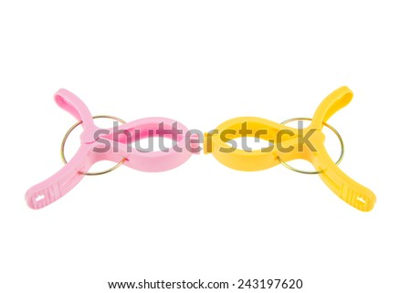 Clothespins on a white background - Business competition ideas and concepts - stock photo