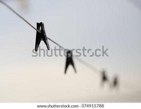 Clothespins on clothesline  - stock photo