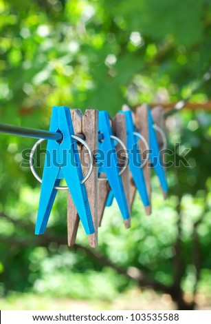 Clothespins on cord - stock photo