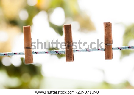 clothespins on rope. - stock photo