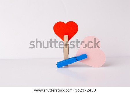 clothespins with paper heart, love, paper, heart. - stock photo