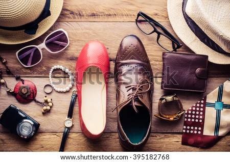 Clothing and accessories for men and women ready for travel - life style  - stock photo