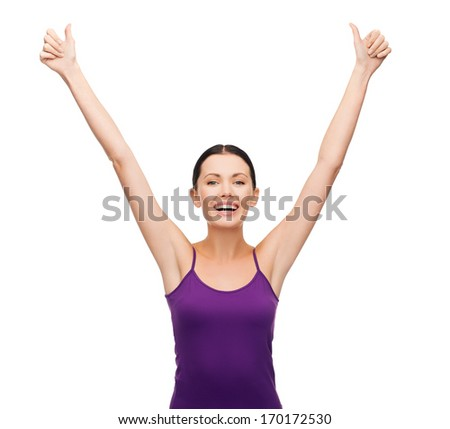 clothing design and happy people concept - smiling girl in blank purple tank top showing thumbs up