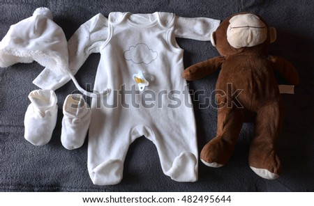 Clothing from baby with Teddy and pacifier doll