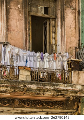 Clothing line on an old balcony  - stock photo