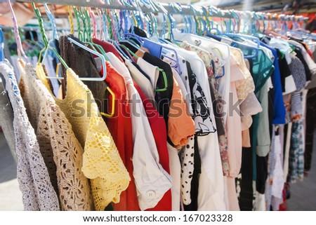Clothing on display racks; Koh Pha Ngan; Thailand - stock photo
