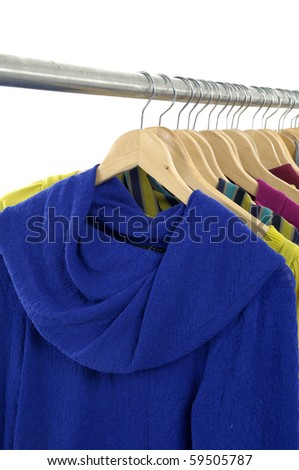 clothing on hanger in a row