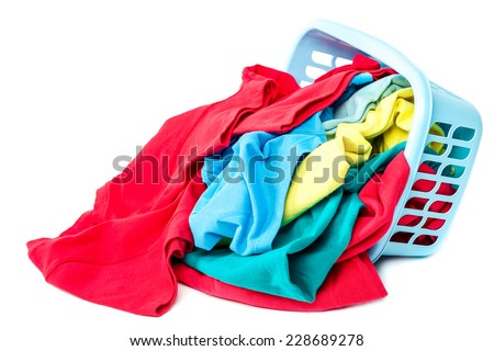 Clothing with a blue container for washing isolated on white background. - stock photo