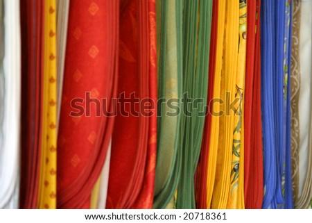 Cloths for curtains in many colors and textures - stock photo