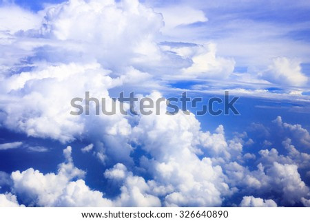 Cloud and blue sky from the airplane windows - stock photo